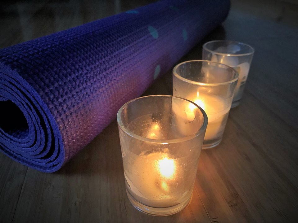 Yoga pad and candles